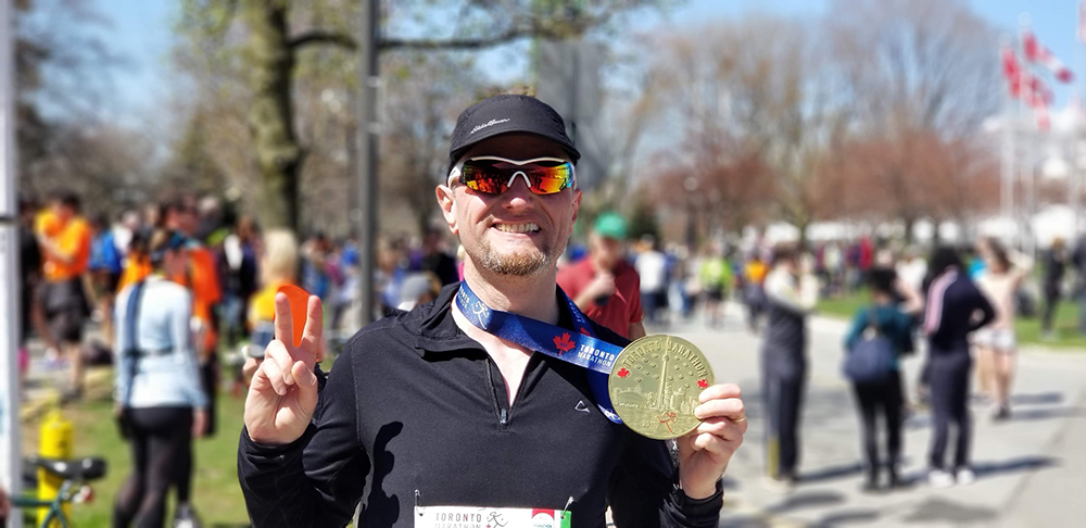 Toronto Marathon 2019 - me with my big ass race medal