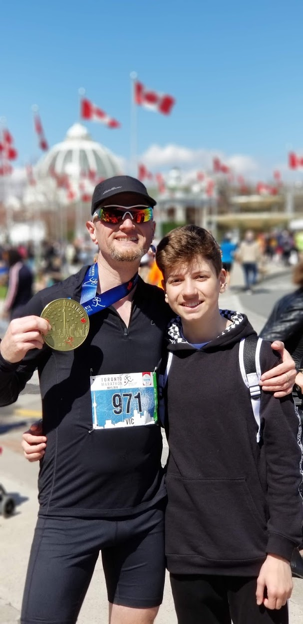 me and my handsome son at the finish line of the Toronto Marathon 2019